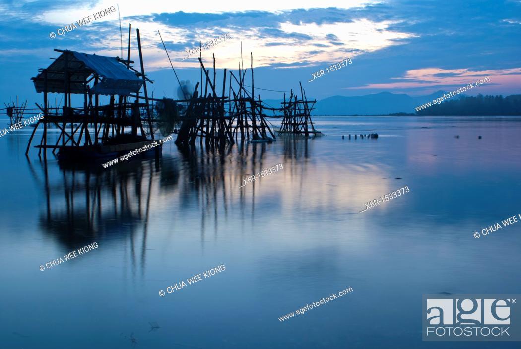Stock Photo: Sunrise on Buntal fishing village, Kuching, Sarawak, Malaysia.