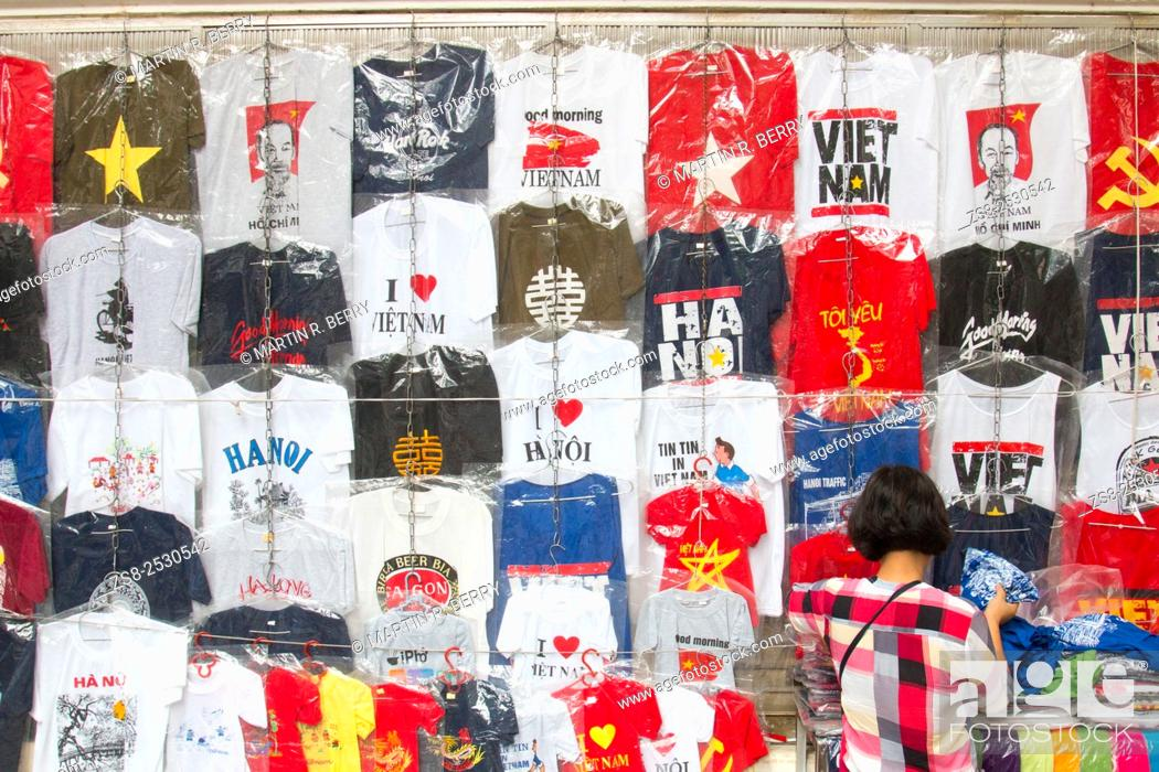 Stock Photo: Tee Shirts for Sale in Hanoi Old Quarter with lady browsing.