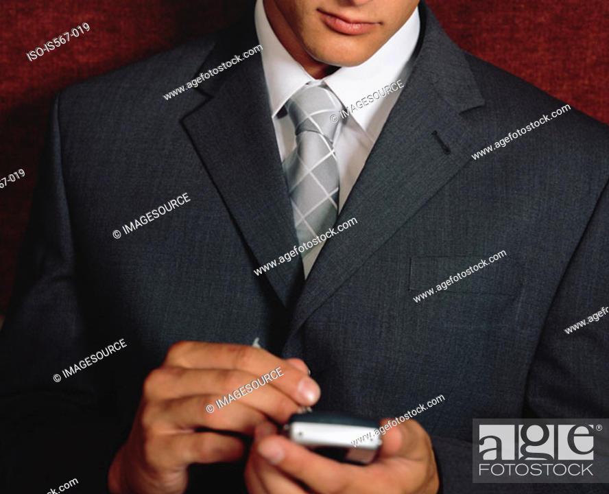 Stock Photo: Businessman using handheld computer.
