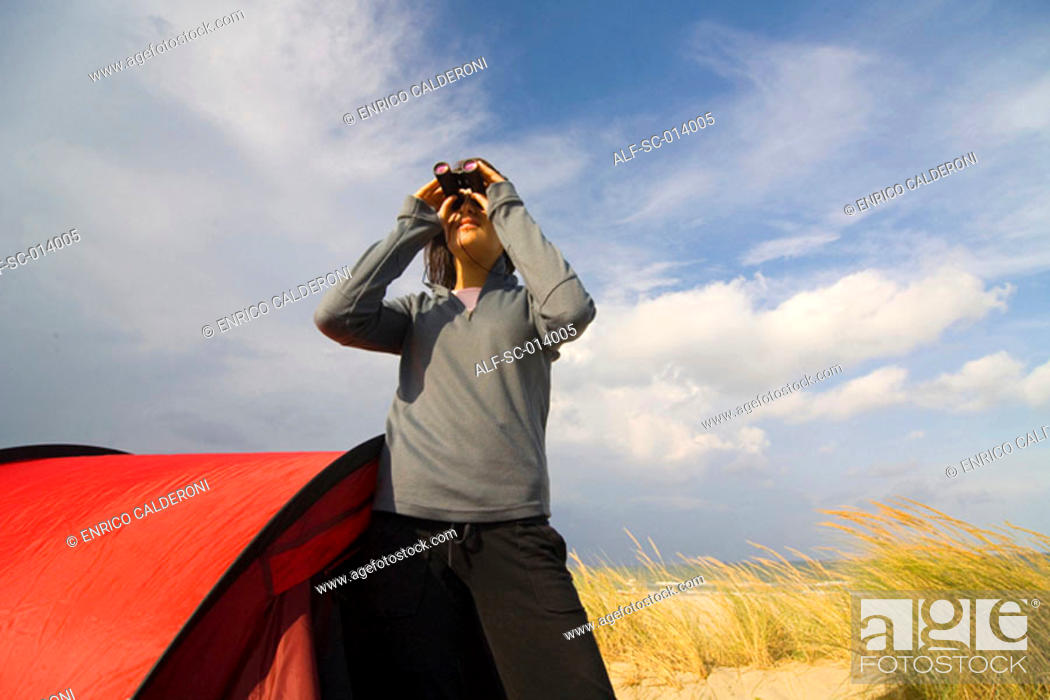 Stock Photo: Camper looking through binoculars.