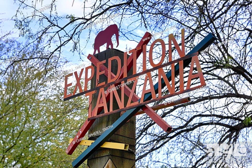 """Stock Photo: """"Expedition Tanzania"""" sign at the entrance to the Elephant area in Reid Park Zoo in Tucson, AZ."""