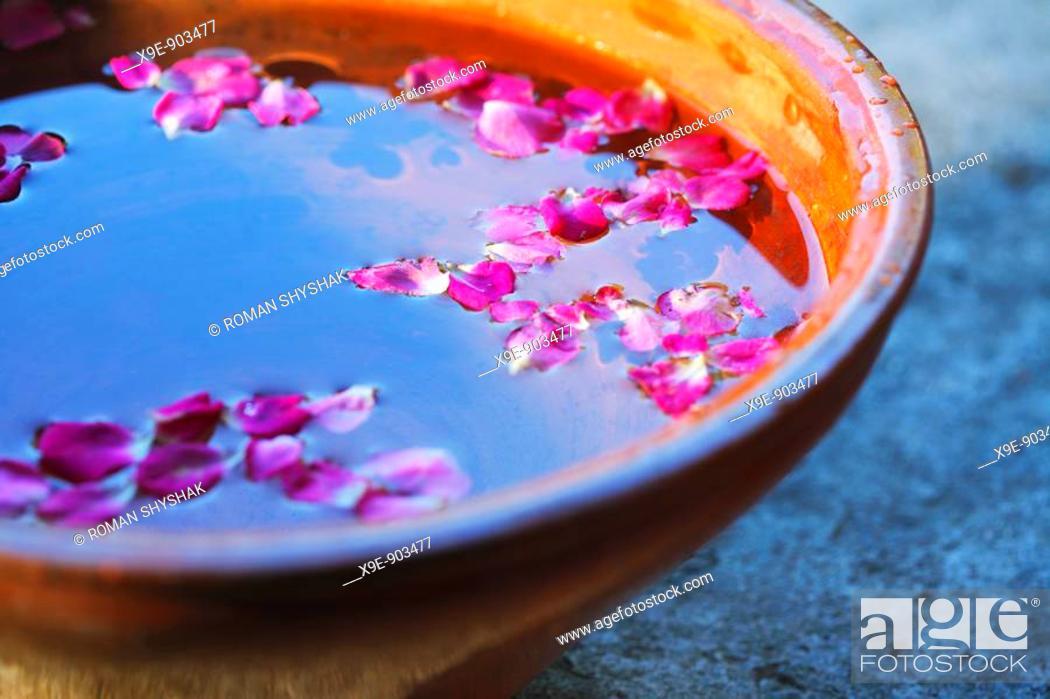 Stock Photo: Pink petals in vessel.