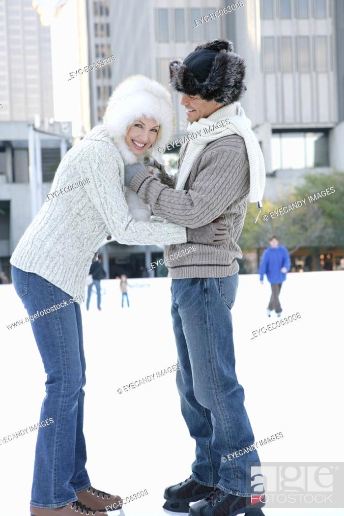 Stock Photo: Mature couple holding each other on an ice skating rink.