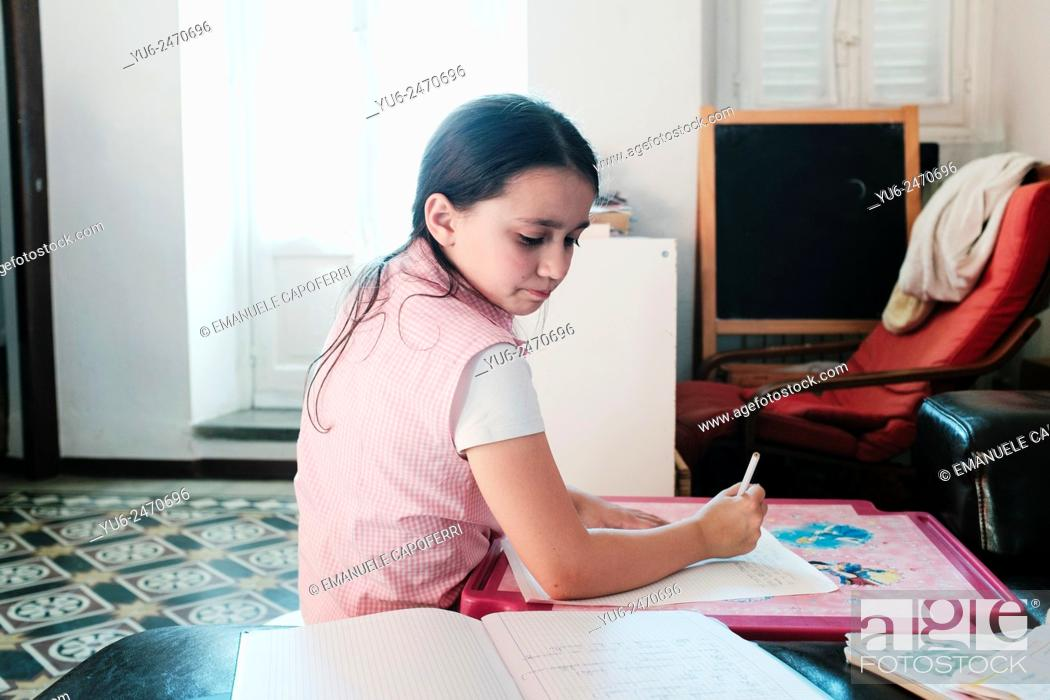 Stock Photo: Portrait of little girl while writing.