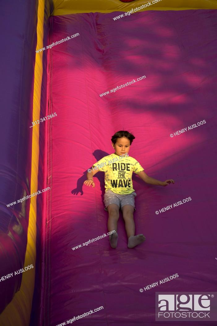 Stock Photo: Young boy plays on a big slider.