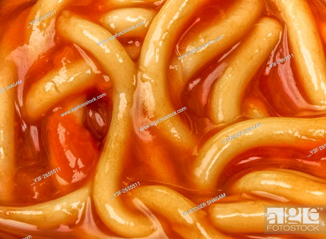 Stock Photo: An open can of Spaghetti in tomato sauce.