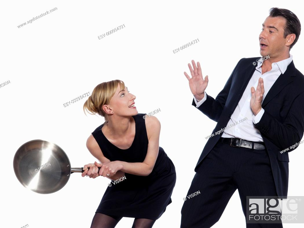 Stock Photo: beautiful caucasian couple on studio white background in funny conflict.