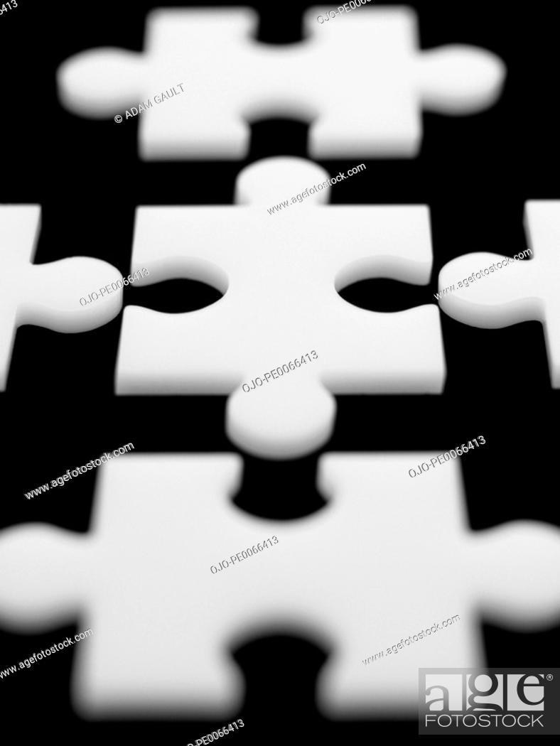 Stock Photo: Close up of puzzle pieces.