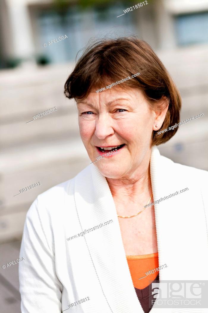 Stock Photo: Portrait of happy senior woman outdoors.