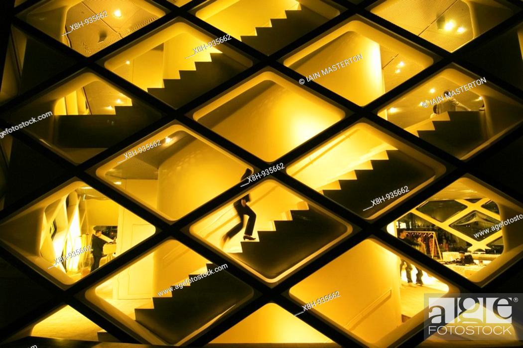 Stock Photo: Exterior view of spectacular illuminated glass walled Prada store in Tokyo Japan.