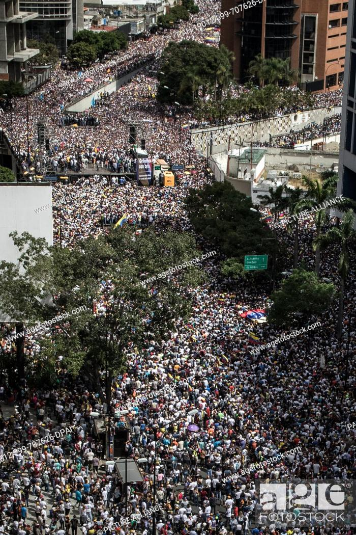 Stock Photo: FILED - 23 January 2019, Venezuela, Caracas: Photo made available on 24.01.2019 - A huge crowd gathered on 23.01.2019 to protest against the government of.