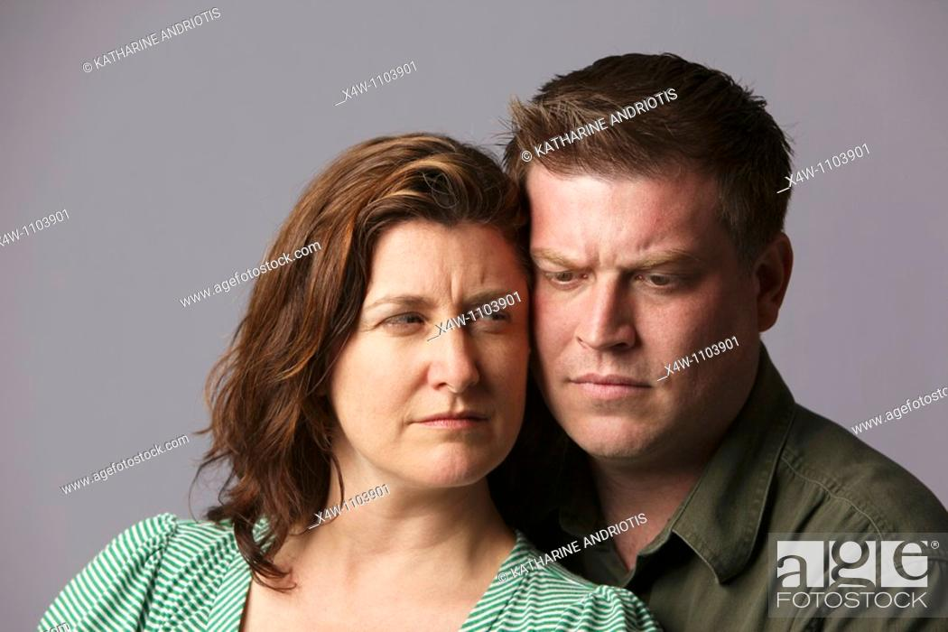 Stock Photo: Unhappy married couple feeling anger and disappointment.