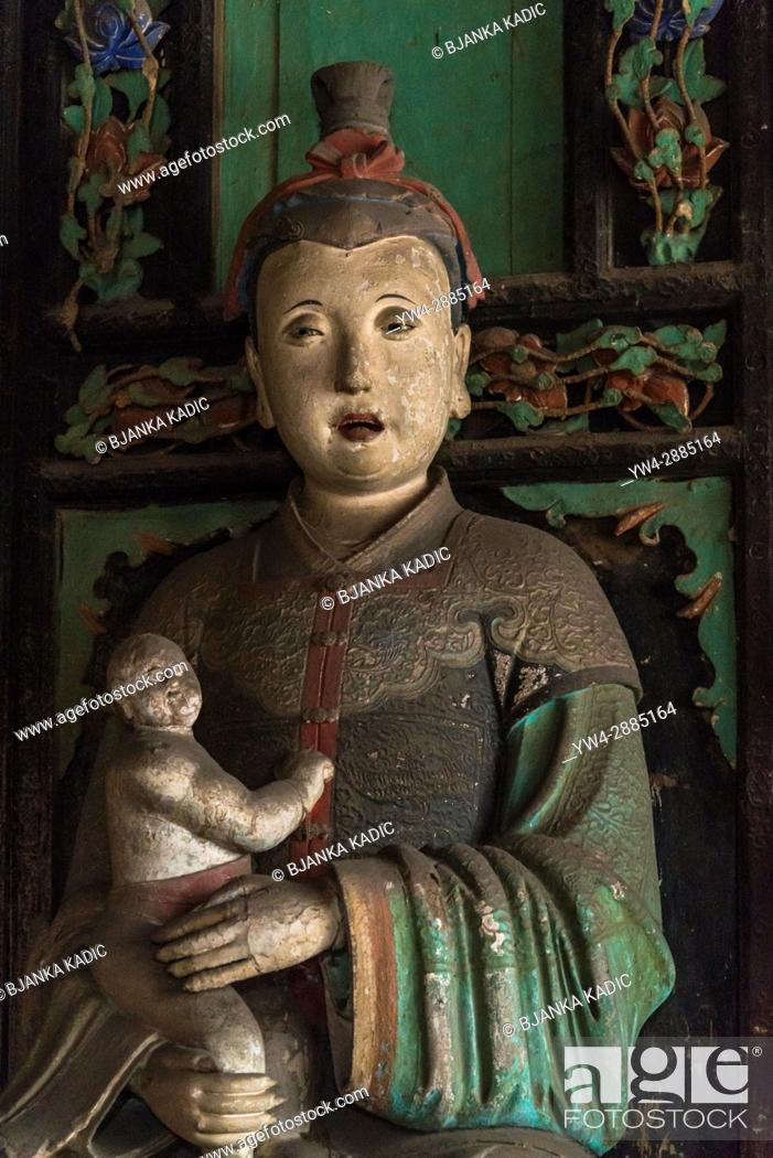 Stock Photo: Mother and child sculpture, Hall of the Fertility Goddess, Shuanglin Temple, a large Buddhist temple from the Ming dynasty, Pingyao, Shanxi province, China.