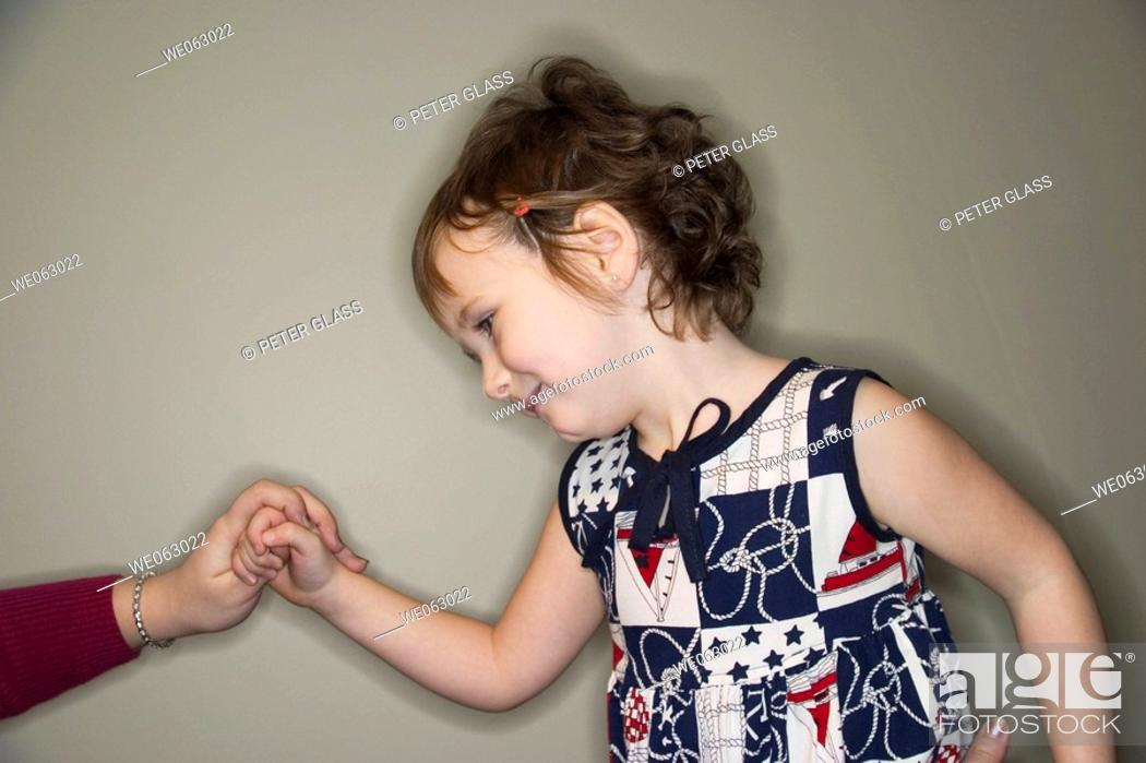 Stock Photo: Young girl holding her mother's hand.