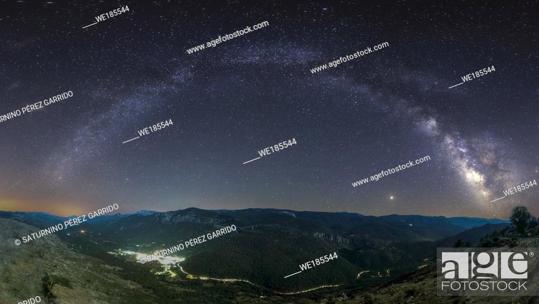 Stock Photo: Set of stars that form the Milky Way over a village of Arroyo Frío, in Sierra Cazorla, Jaén, Spain.