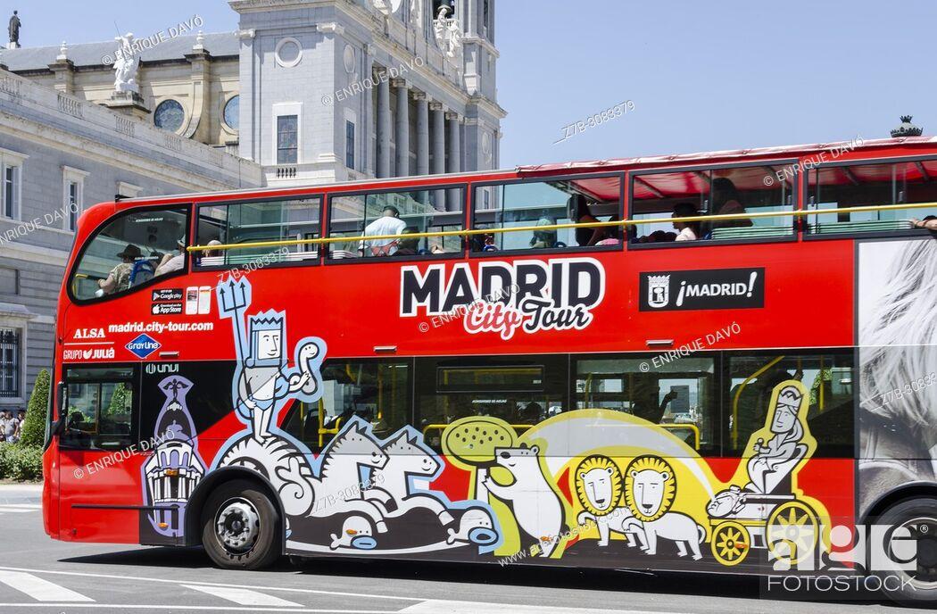 Stock Photo: A touristic red bus view close to Palacio de Oriente. Madrid, Spain.