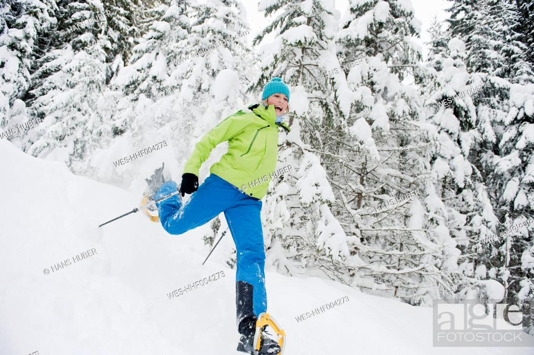 Stock Photo: Austria, Salzburg County, Young woman snowshoeing.