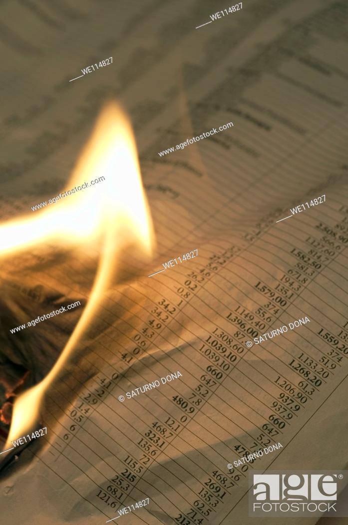Stock Photo: Burning financial newspaper with stock index.