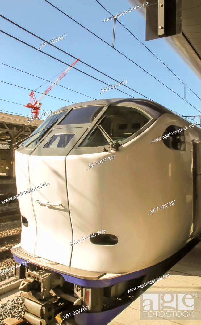 Stock Photo: Kyoto, Japan - 2010: The Limited Express Haruka at arrives at Kyoto on a clear day. The Kansai Airport Express Haruka is a fast.