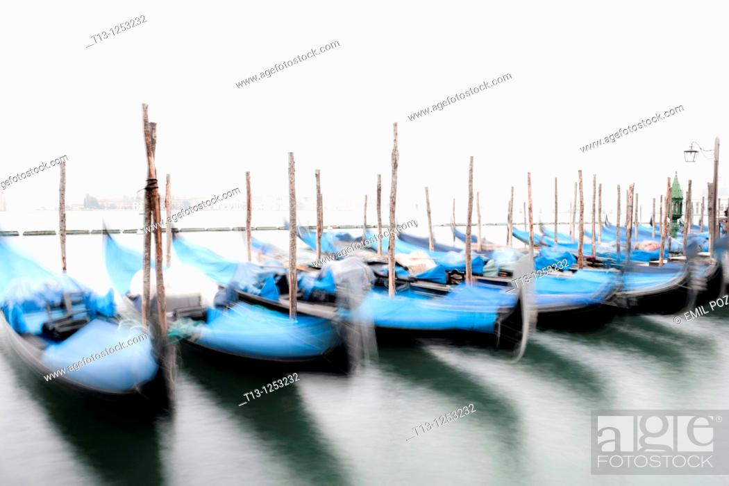 Stock Photo: Moored gondolas in Venice Italia, long exposure tripod shot.