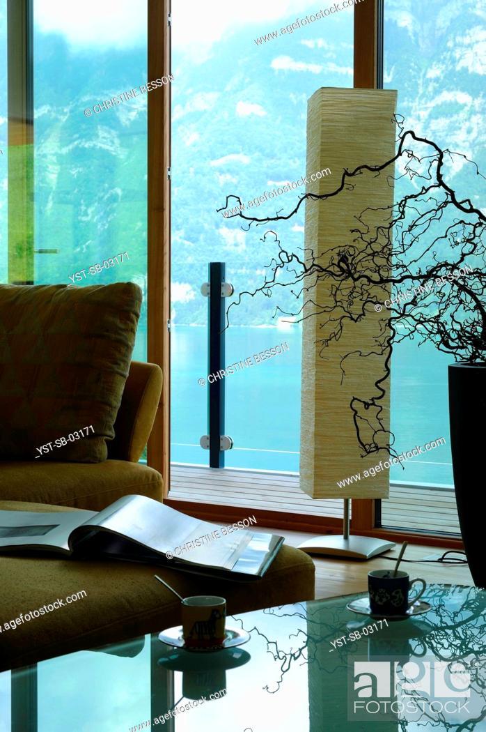 Stock Photo: Slope, suspended house, Lake Walen, Glarus, Switzerland.
