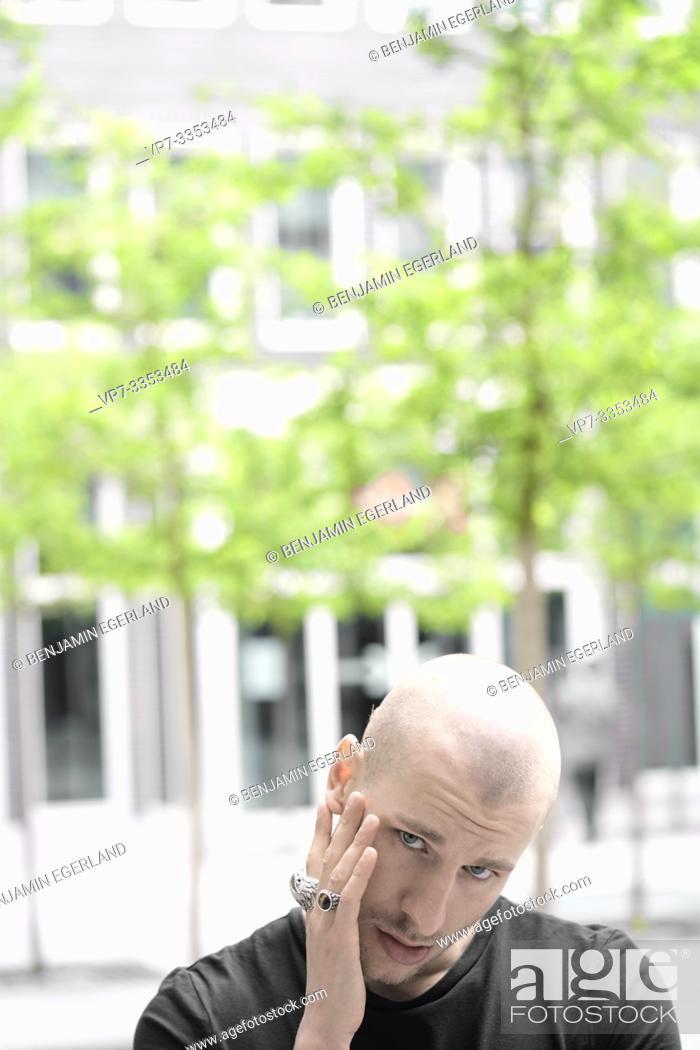 Stock Photo: Mischievous man in residential area.