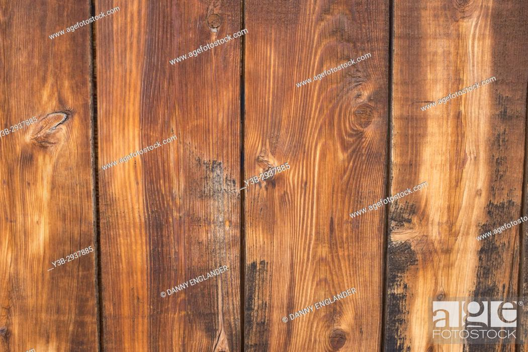 Stock Photo: Close-up detail of grainy wooden fence planks.