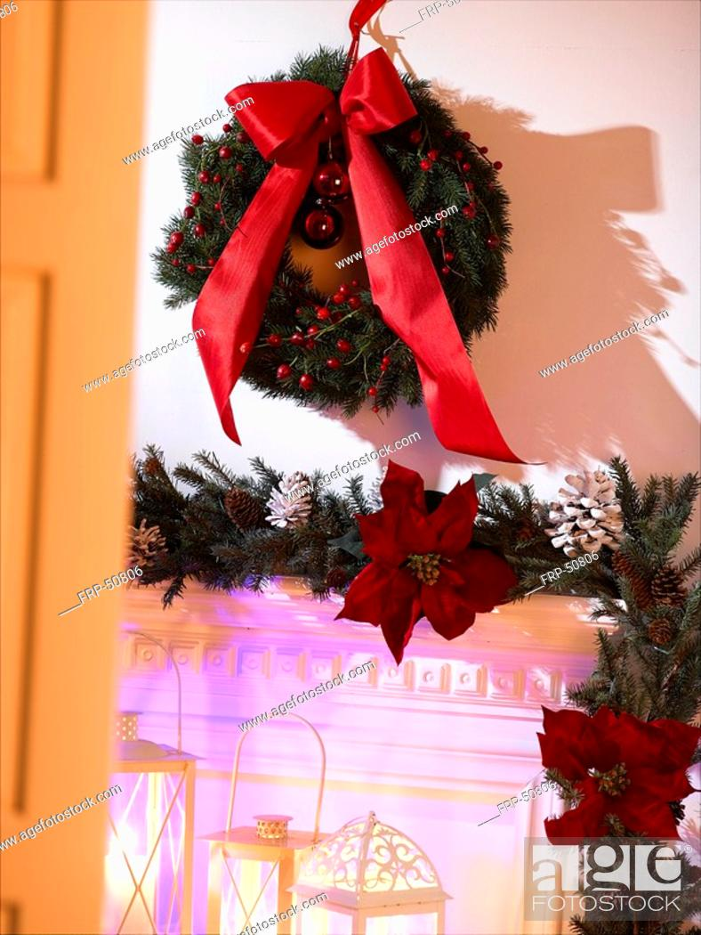 Stock Photo: Advent wreath with a red ribbon hanging on the wall.