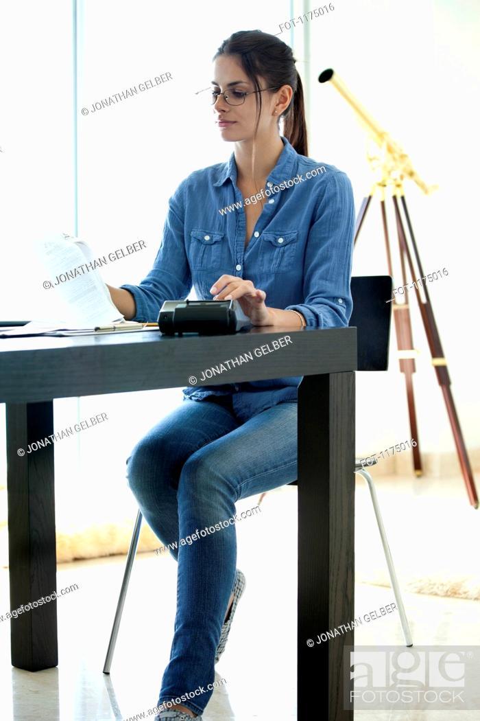 Stock Photo: Woman doing her finances.