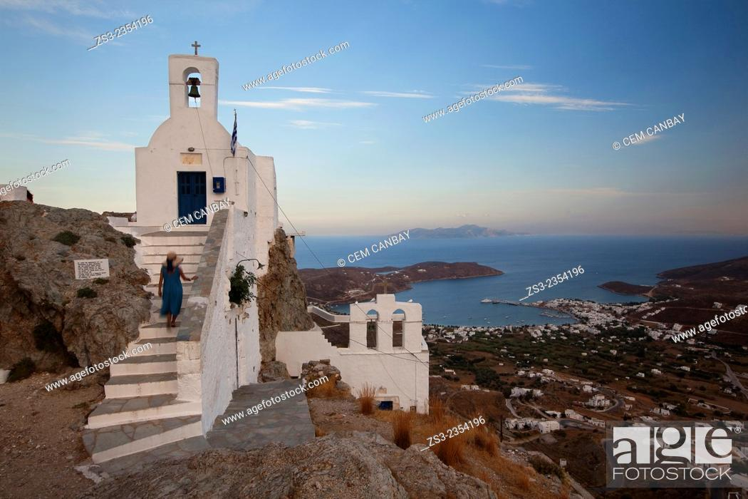 Stock Photo: Woman climbing up the stairs of the Agios Constantinos church in Hora, Serifos, Cyclades Islands, Greek Islands, Greece, Europe.