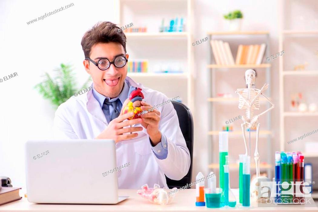 Stock Photo: Funny doctor having fun in hospital lab.