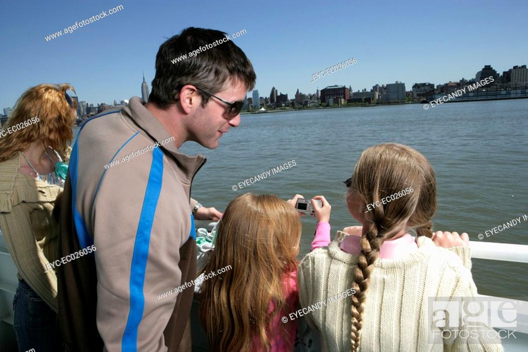 Stock Photo: Family of four sightseeing.