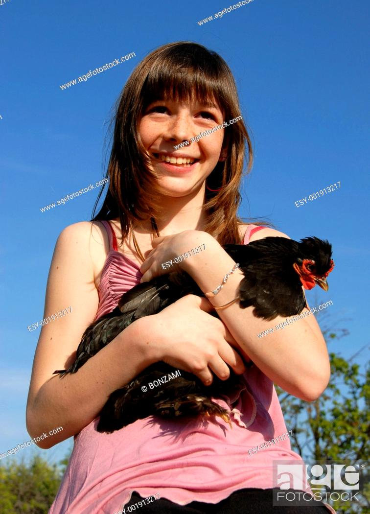 Stock Photo: happy girl and chicken.