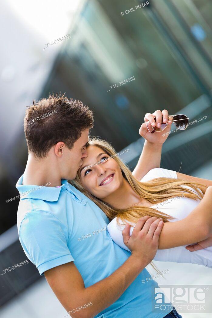 Stock Photo: Teen couple girl and boy happy kiss on forehead.