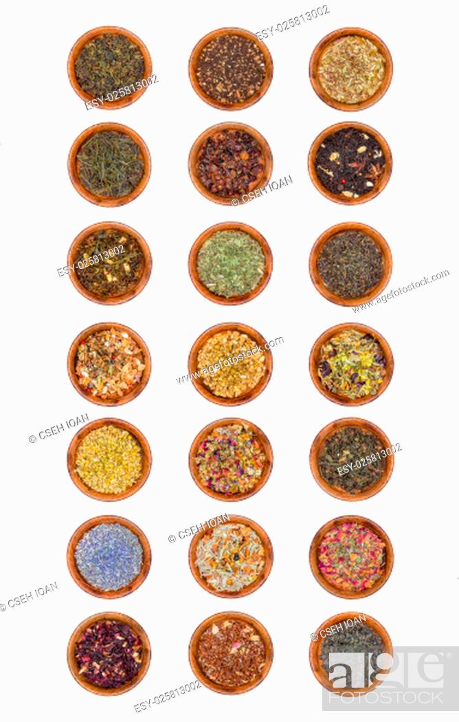 Stock Photo: 21 samples of tea leaves green, black and herbal tea in wooden bowl isolated on white.
