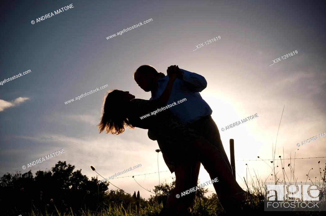 Stock Photo: Couple at sunset in Tuscany Italy.
