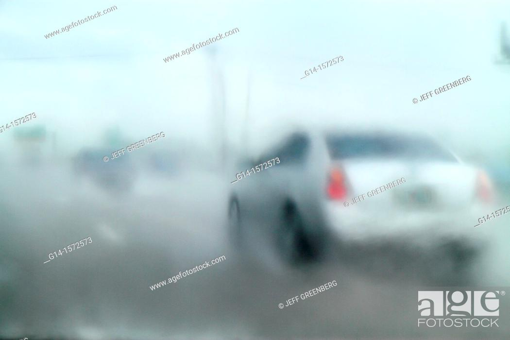 Stock Photo: Florida, Hollywood, Interstate 95, I-95, rain, raining, heavy, downpour, limited visibility, highway, driving, traffic, dangerous, cautious.