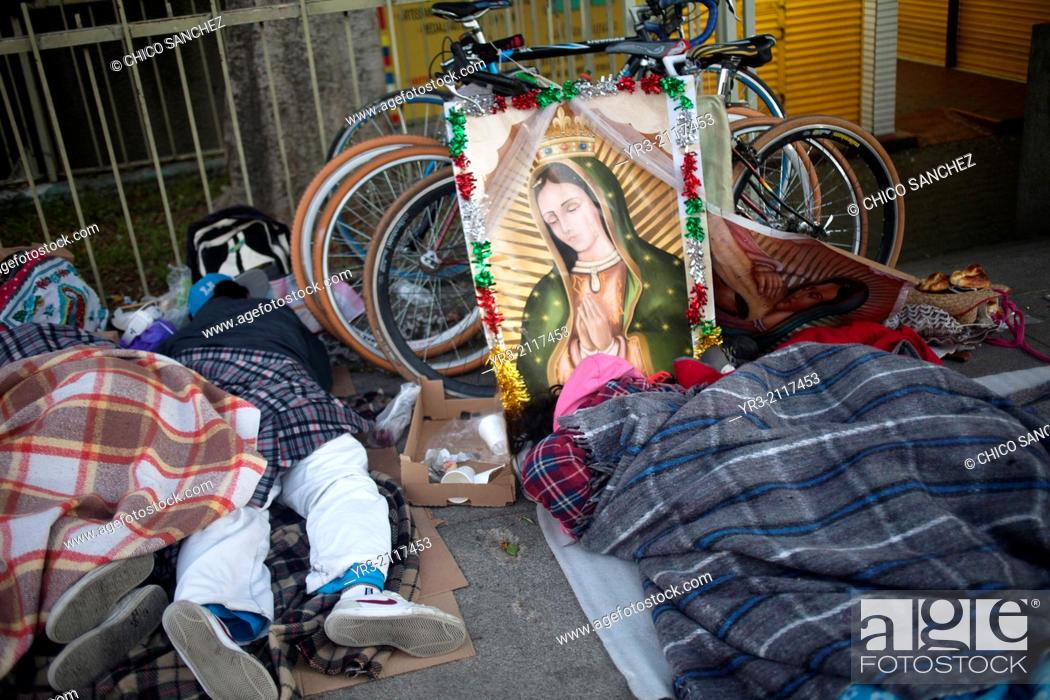 Stock Photo: Pilgrims sleep by their bicycles at the pilgrimage to Our Lady of Guadalupe Basilica in Mexico City, Mexico, December 10, 2013.
