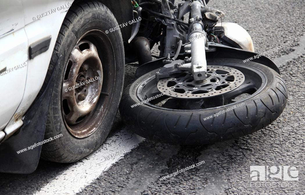 Stock Photo: Car collided with a motorbike.