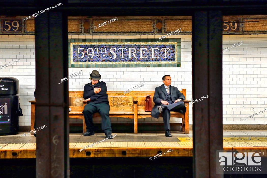 Two Men Seated On A Bench Waiting For 6 Subway Train 59th And