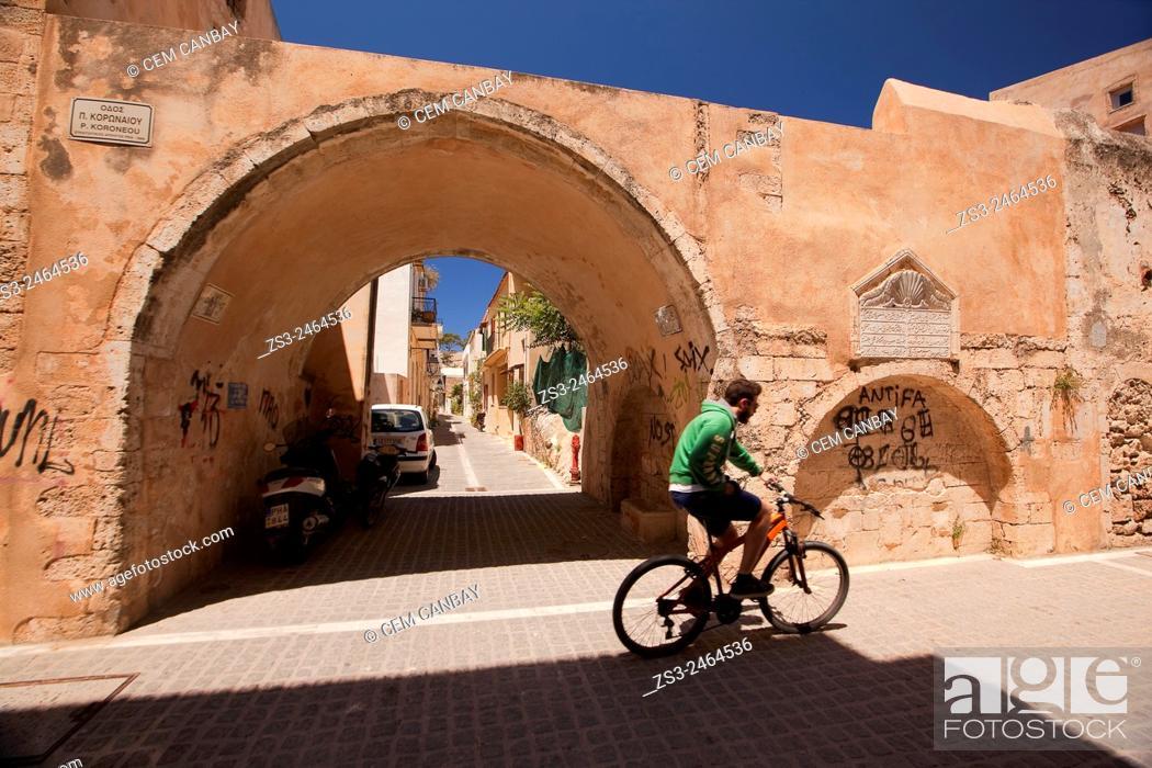 Man riding on a bike in the street, Rethymno, Crete, Greek Islands