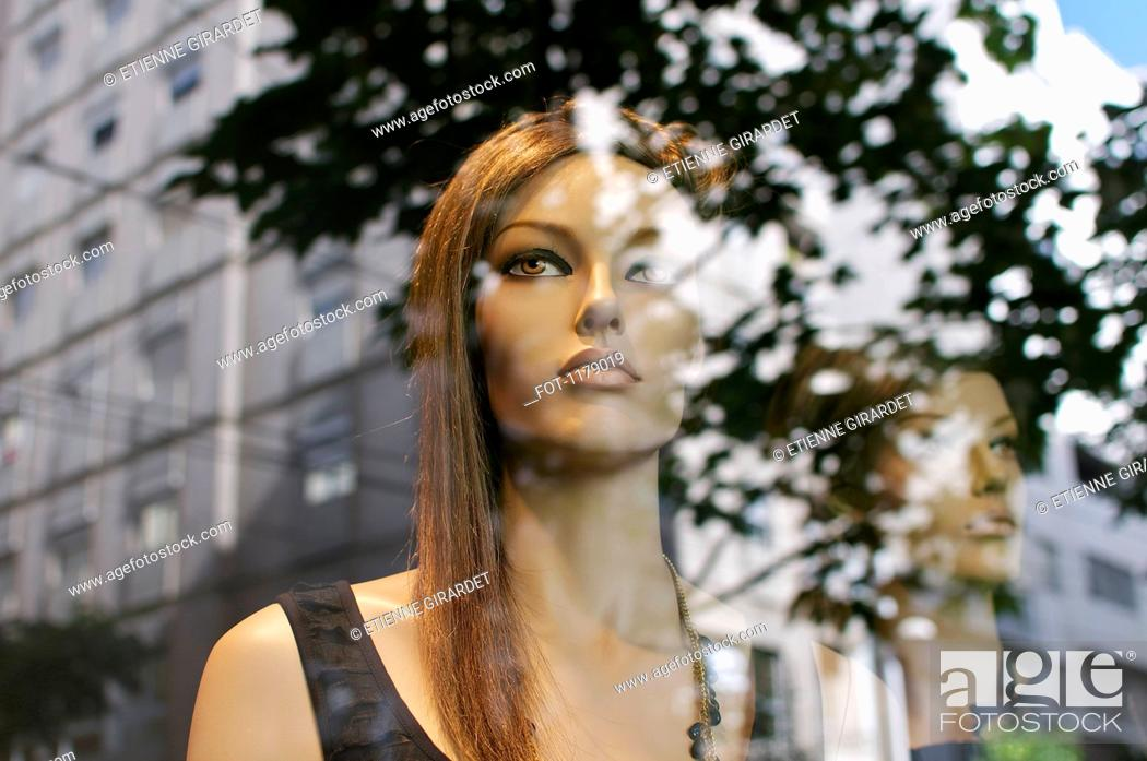 Stock Photo: Mannequins looking at the street buildings.