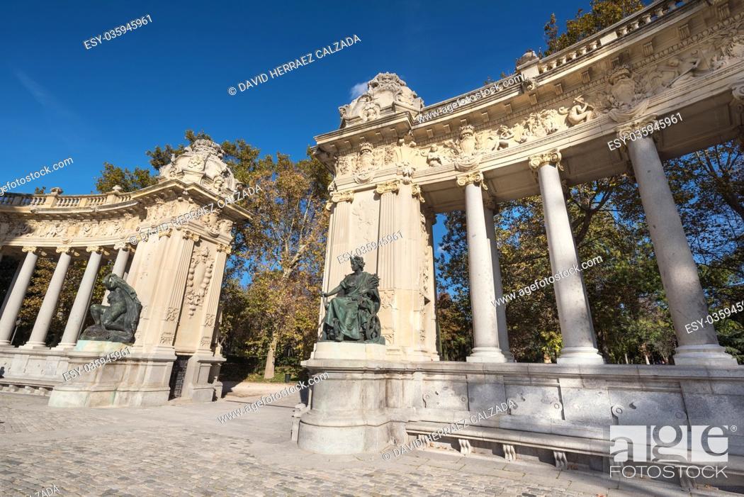 Stock Photo: Madrid, Spain - November 13, 2016: Tourist visiting Alfonso XII monument on November 13, 2016 in Retiro park, Madrid, Spain.