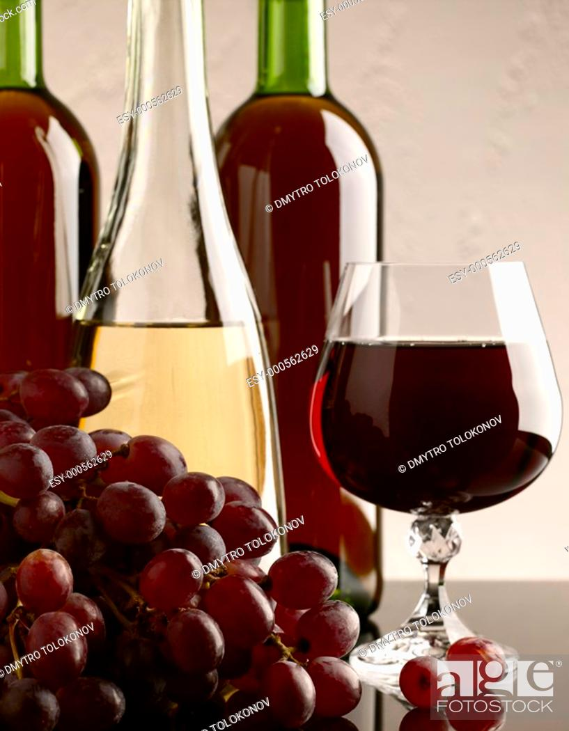 Stock Photo: winery still life on the glass with red and white wine.