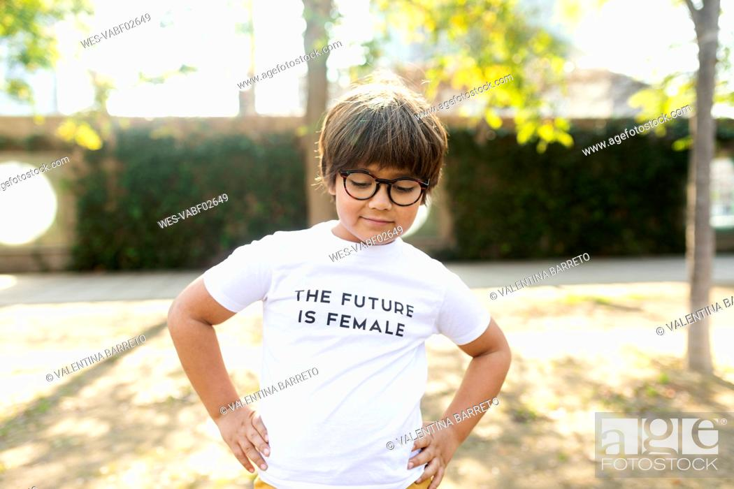 Stock Photo: Proud little boy standing in the street with print on t-shirt, saying the future is female.