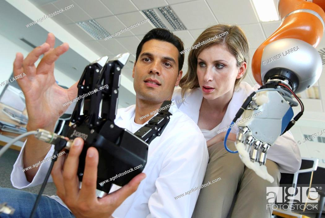Stock Photo: Humanoid robot for automotive assembly tasks in collaboration with people and and LWR robot, using haptic teleoperation with force feedback.