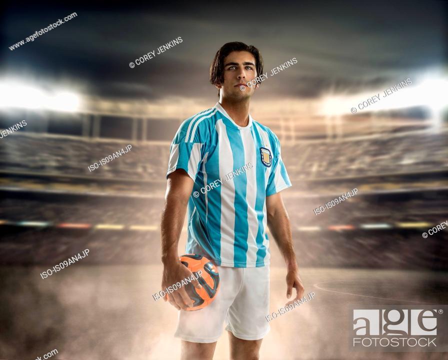 Stock Photo: Footballer holding ball.