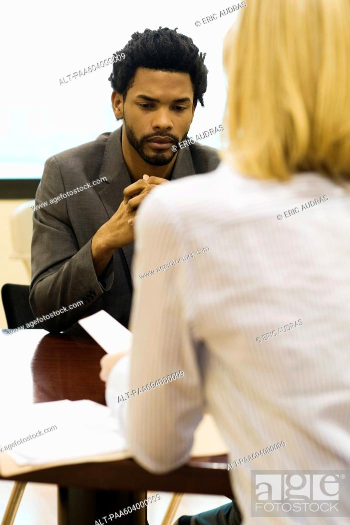 Stock Photo: Professional man undergoing job performance evaluation.