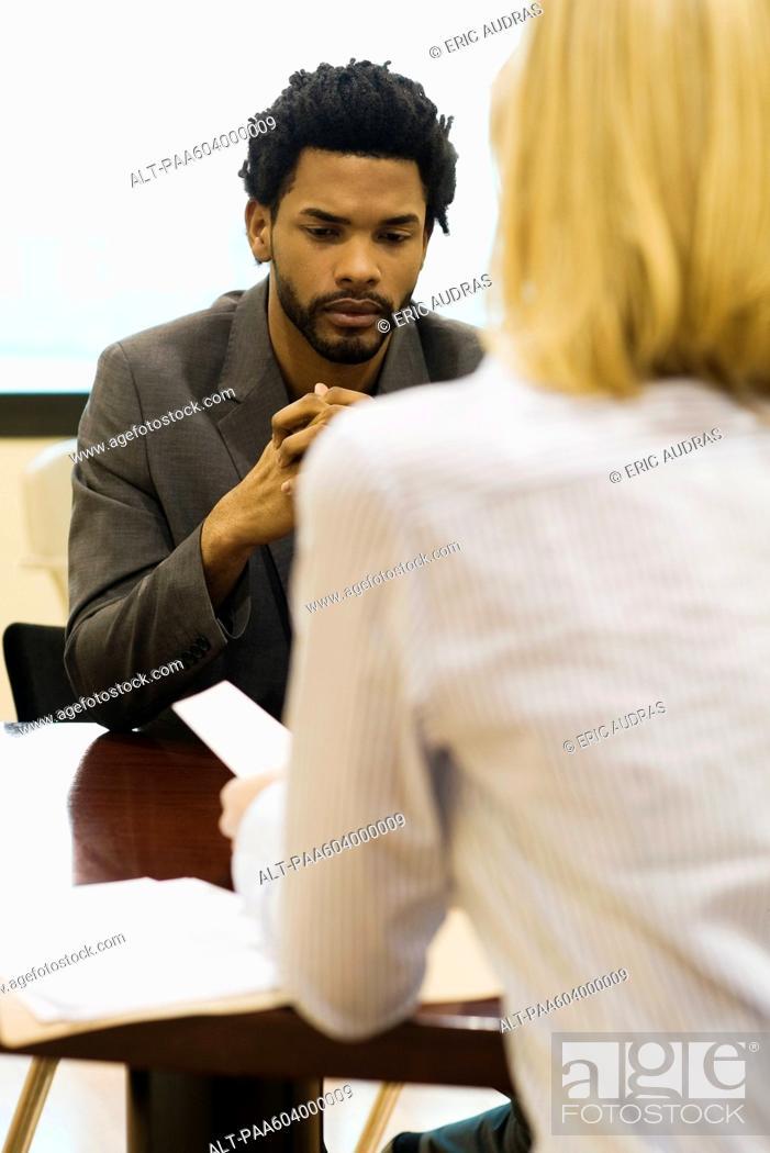Stock Photo: Professional man undergoing job performance evaluation.