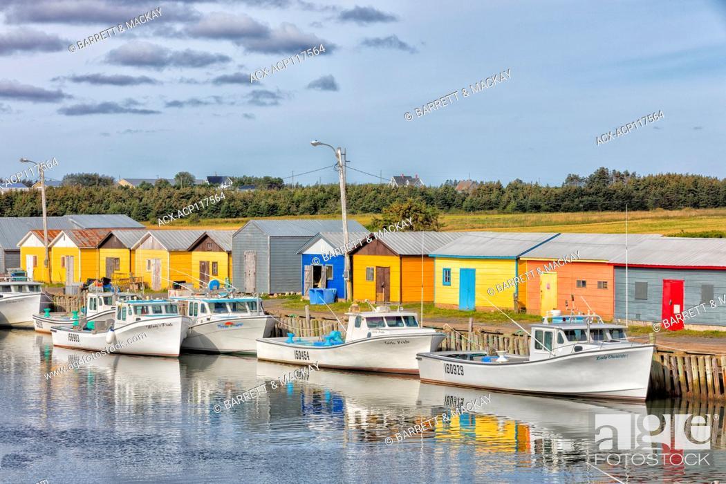 Stock Photo: Fishing boats tied up at wharf, North Lake, Prince Edward Island, Canada.